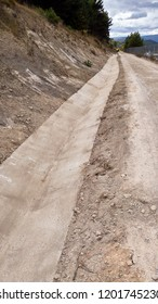 newly constructed ditch at the edge of a road