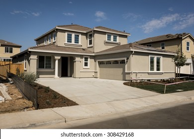 A newly constructed house within a developing residential subdivision