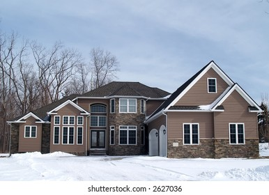 A newly constructed large home in a suburban development