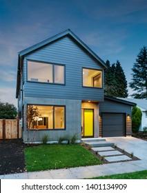 Newly designed modern house with soft light illuminating the interior