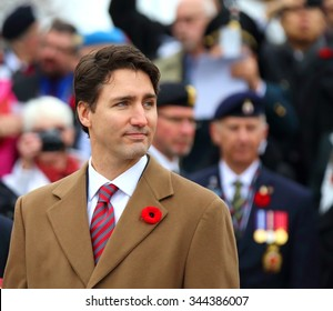 Newly elected Canadian Prime Minister Justin Trudeau placed a wreath during the Remembrance Day ceremony at the National War Memorial in Ottawa Nov. 11, 2015.