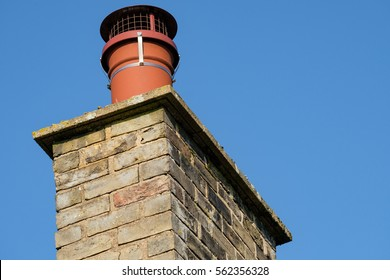 Newly installed chimney cap used to prevent birds nesting on an old cottage chimney pot.