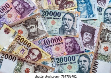 Newly introduced Hungarian Forint banknotes scattered on plain surface