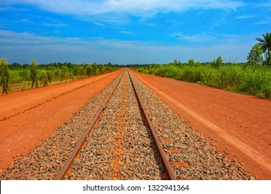 A newly laid section of rail track between Kamsar and Sangaredi in the west of the Guinea for the delivery of bauxite by mining shuttle trains. Guinea, Africa.
