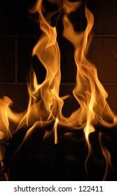 A newly lit fire burning high.