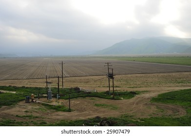 A newly planted California farm field with electric substation for local power