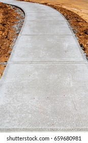 Newly Poured Concrete Sidewalk at Residential Construction Site