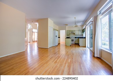 newly remodeled finished traditional North America single family home kitchen with oak cabinet and floor empty
