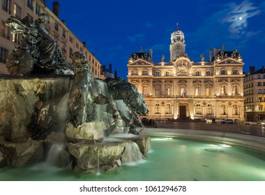 The newly renovated fountain in the center of Lyon, square Terreaux, at twilight. Lyon, France.