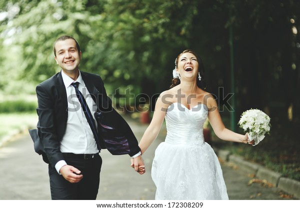 Newly wed couple going crazy. Groom and bride together.