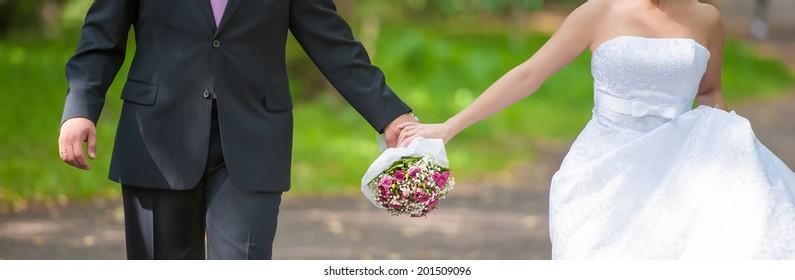 newly wed couple on a walk