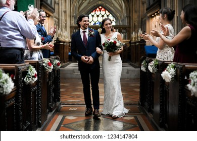 Newly wed couple walking down the aisle