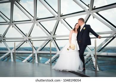 Newly weds cuddling: bride resting her head on groom's shoulder