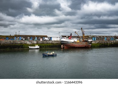 NEWLYN, ENGLAND - JUNE 20: Small fishing boat returning to harbour, in Newlyn. In Newlyn, Cornwall, England. On 20th June 2018.