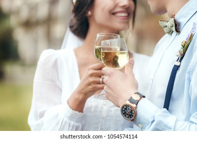 newlyweds drink champagne in the open air