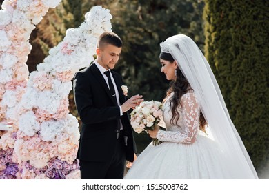 Newlyweds exchange rings during their beautiful wedding ceremony outdoors. Newlywed woman with wedding rings. Wedding ceremony. Wedding for two. Couple in love.