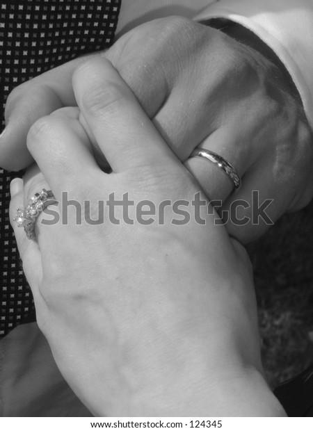 Newlyweds holding hands black & white