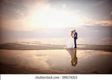 Newlyweds on the shore