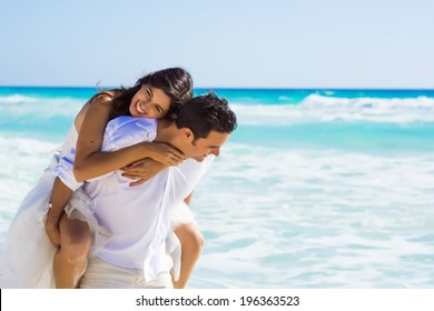Newlyweds sharing a romantic and fun moment at the beach