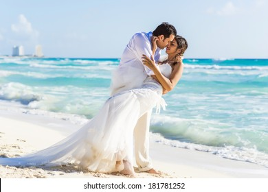 Newlyweds  sharing a romantic moment at the beach