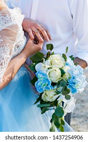 Newlyweds wear rings. Wedding ceremony. The bride's bouquet. Bride and groom with rings.