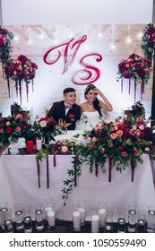 Newlyweds at the wedding table. Congratulation of the newlyweds at the wedding table.