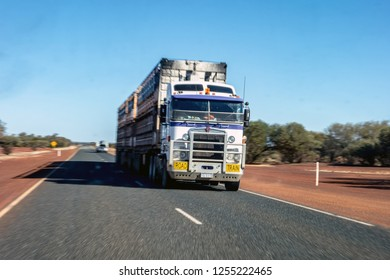 NEWMAN - WESTERN AUSTRALIA - JULY 11, 2018: The Kenworth road train truck on an asphalt road in Western Australia near Newman city. The image is taken with a strong motion blur effect.