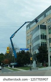 Newmarket, Ontario / Canada - October 12 2018: A Torcan worker is positioning his Lift to start work. Torcan provides quality aerial lift and material handling equipment in and around the GTA.