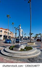 Newport Beach, CA / USA - January 24, 2019: Statue of Lifeguard Ben Carlson by the Newport Beach Pier