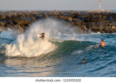 Newport Beach, CA / USA - July 5, 2018: A body boarders gets tossed around in the waves at The Wedge in Newport Beach