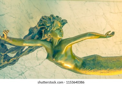 Newport Beach, CA / USA - July. 21, 2018:  Mermaid Statue Shines in Sunlight Near the Newport Pier