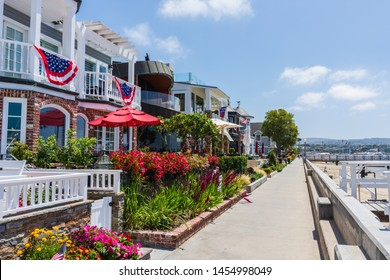 Newport Beach , CA USA - July 18, 2019: Balboa boardwalk and Balboa Island area of Newport Beach with tourist activities for shopping, eating, walking and enjoying the island, bay, beach, and pier.