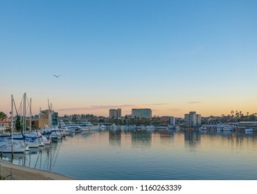 Newport Beach, CA / USA - June 20 2018: The sun comes up over Newport Beach harbor