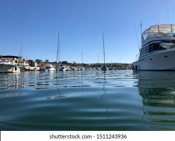 Newport Beach, CA / USA - March 18 2019: Waterside view of the boats at anchor in the Balboa Harbor near Newport Beach California