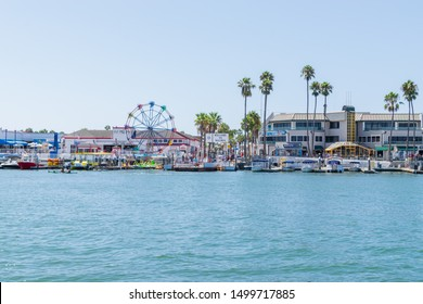 Newport Beach , CA USA - September 8, 2019: Balboa boardwalk and Balboa Island in Newport Beach with tourist activities for shopping, eating, walking the island, bay, beach, and pier in a safe area.