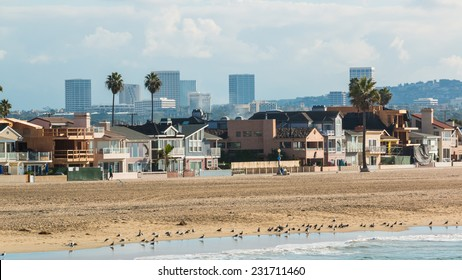 Newport Beach California 3. The coastline of Newport Beach, California on a hazy sunny morning with the Irvine city skyline in the distance.