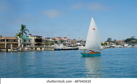 NEWPORT BEACH, CALIFORNIA: JULY 2017. Young sailors enjoy an afternoon sailing in Newport Harbor in southern California.