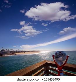Newport beach in California view from pier binocular telescope