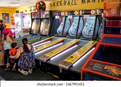 Newport Beach, California/United States - 07/15/19: A family play a round of skee ball at an arcade