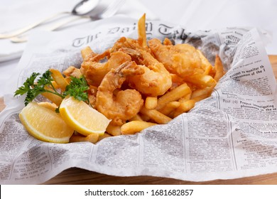 Newport Beach, California/United States - 07/30/2019: A view of a basket of shrimp and chips, in a restaurant or kitchen setting.