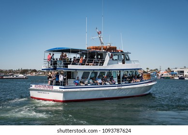 NEWPORT BEACH, CA/U.S.A. - MARCH 27, 2018: A whale watching boat from Ocean Explorer Cruises departs the harbor area to the open ocean during prime grey whale migration season.