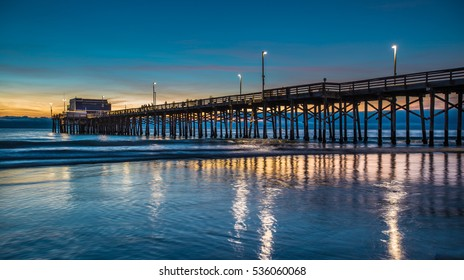 Newport Beach Pier - After Sundown, the light and shadows reflecting off the water are captivating