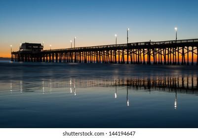 Newport beach pier in Orange county, California, golden sunset light