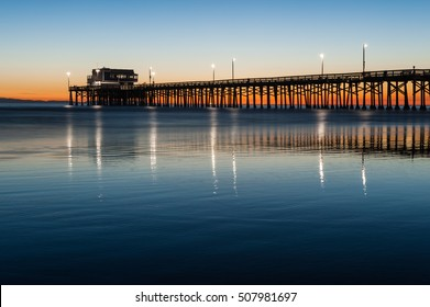 Newport beach pier silhouette sunset