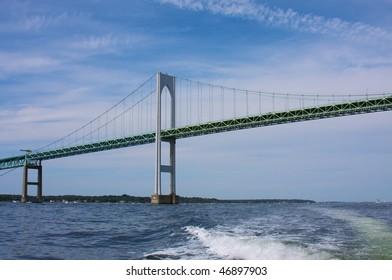 Newport Bridge in Rhode Island  over ocean with beautiful blue sky