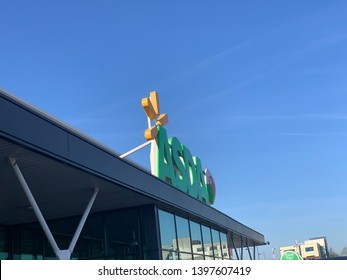 Newport, Gwent, Wales 14/05/2019. Asda superstore shop front with the Green Asda sign on the roof. Room for text on blue sky background.