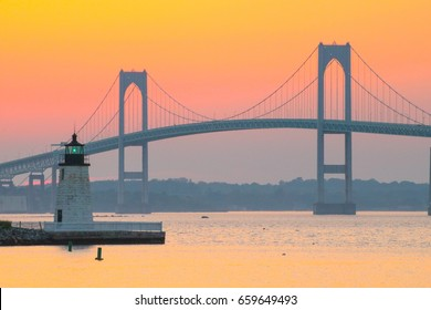 Newport Harbor Lighthouse and the Newport Bridge at sunset, located in the Narragansett Bay. Newport is an international sailing and tourist destination. New England coastal town. Travel, Vacation
