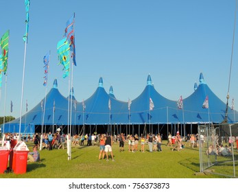 Newport, Isle of Wight, United Kingdom - June 13th, 2014: The Big Top and flags at the Isle of Wight Music Festival.