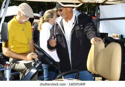 NEWPORT NEWS, VA- OCTOBER 25: Dennis Gage of My Classic Car signing a license plate in the 11th Annual Virginia Fall Classic in Newport News Park in Newport News, Virginia on October 25, 2013