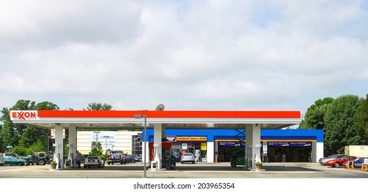 NEWPORT NEWS, VIRGINIA - JULY 3, 2014: An Exxon gas and service station on Jefferson Ave in Newport News VA. Exxon Mobil is the 3rd largest company in the world by revenue (420 billion USD in 2013).